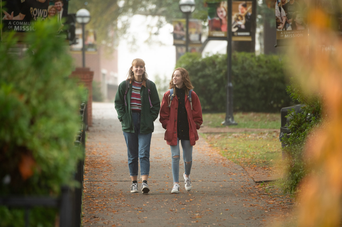 This is a photo of two students walking on campus.