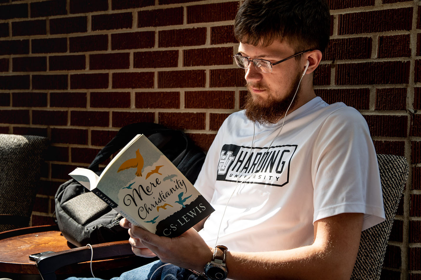 This is a photo of a student reading Mere Christianity.