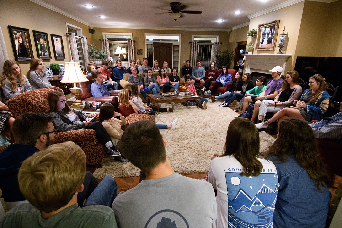 This is a photo of students at a home Bible study.